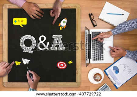 Q&A - Question and Answer Businessman working at office desk and using computer and objects on the right, coffee,  top view, with copy space - stock photo