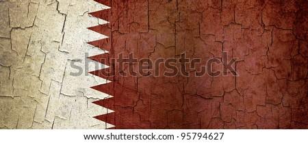 Qatar flag on a cracked grunge background - stock photo
