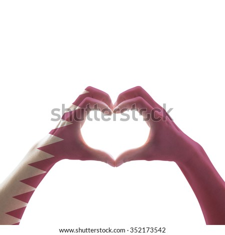 Qatar flag pattern on people hands in heart shape isolated on white background, symbolic sign language expressing love, unity, harmony of people in the country/ nation concept: Happy national day    - stock photo