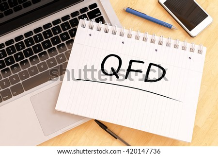 QFD - Quality Function Deployment - handwritten text in a notebook on a desk - 3d render illustration. - stock photo