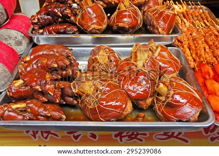 QIBAO, SHANGHAI-MARCH 16, 2010: typical Chinese roasted pig legs. Qibao water village is Shanghai tourist attraction with 1000000 visitors year. - stock photo
