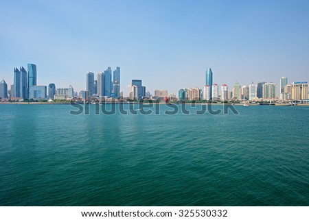 Qingdao, China - September 17, 2015: A beautiful view of Qingdao Skyline harbor. - stock photo