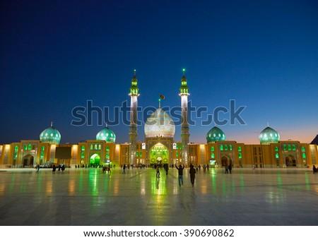 QOM, IRAN - March 09, 2016:  People walking in the yard of Jamkaran mosque. Qom, Iran - stock photo