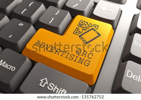 QR Code Advertising Concept. Orange Button on Computer Keyboard. - stock photo