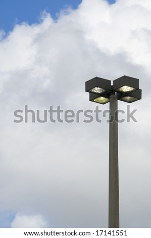 Quad head street light on during the day