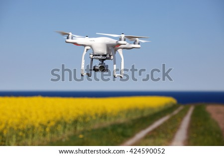 Quadrocopter, copter, drone in action - stock photo