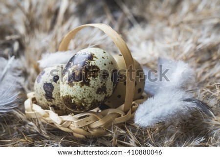Quail eggs in a small decorative basket.Selective focus - stock photo