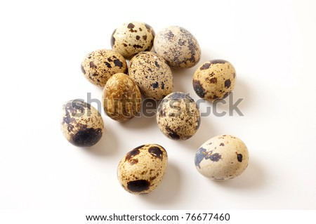 quail eggs on a white background - stock photo