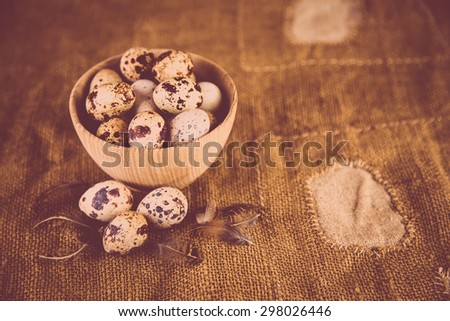 Quail eggs on an old background - stock photo
