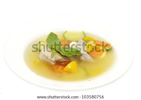 quail soup and vegetables on a white background - stock photo
