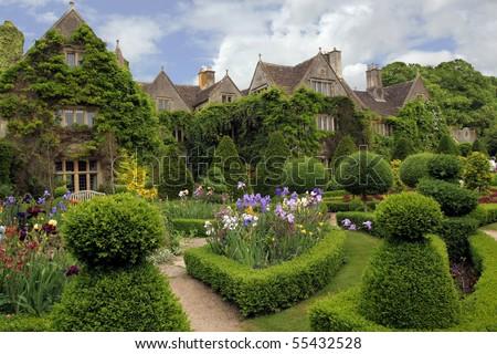 Quaint, charming English cottage - stock photo