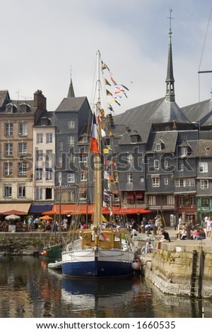 Quaint old French fishing port in Normandy. - stock photo
