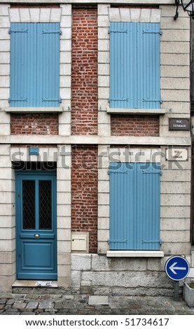 Quaint street view in Louviers, France. Closed shutters. Old building.