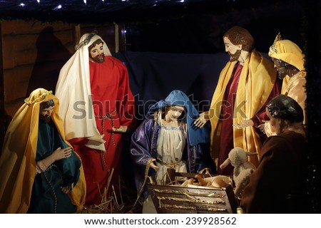 QUAKERS HILL, AUSTRALIA - DECEMBER 24 2014;  Nativity scene Mary, birth of Jesus in manger with Wise Men in stable  worship gifts. - stock photo