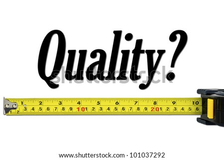Quality Control And Measurement Concept With A Tape Measure - stock photo