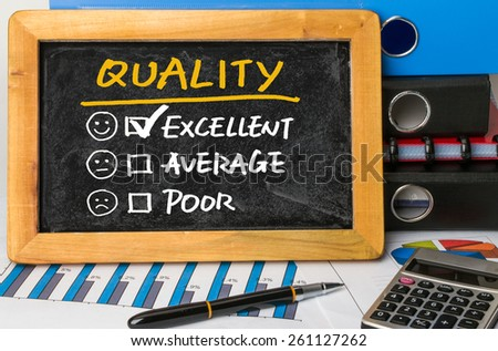 quality evaluation concept on blackboard - stock photo