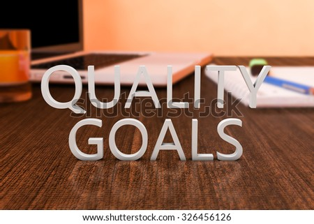 Quality Goals - letters on wooden desk with laptop computer and a notebook. 3d render illustration.