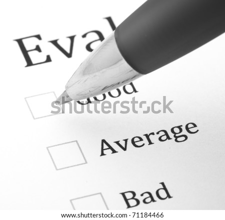 quality questionnaire and pen, extreme closeup photo - stock photo