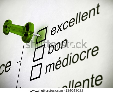 Quality survey close up with a thumbtack pointing on the word excellent - stock photo