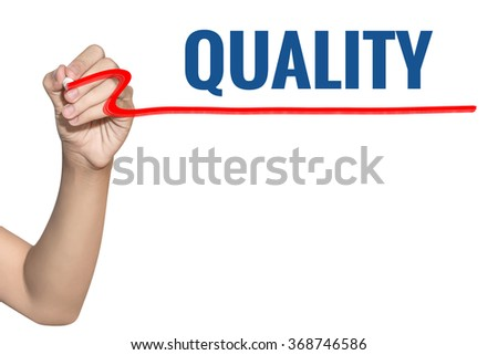 Quality word write on white background by woman hand holding highlighter pen - stock photo