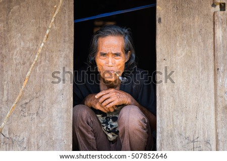 Quang Binh, Vietnam - June 17, 2016: Portrait of old Bru Van Kieu ethnic minority man living in Doong ethnic village