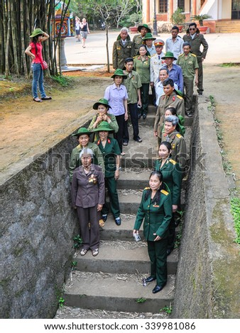Quang Tri, Vietnam - Apr-15-2011: North Vietnam Army veterans of the Vietnam-American war gather by the steps of Entrance #13 to Vin Moc tunnels to commemorate their wartime sacrifices and struggles.