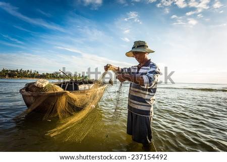 QUANG TRI, VIETNAM - JUNE,10: Fishermen at dawn. JUNE 10, 2014 in QUANG TRI, VIETNAM