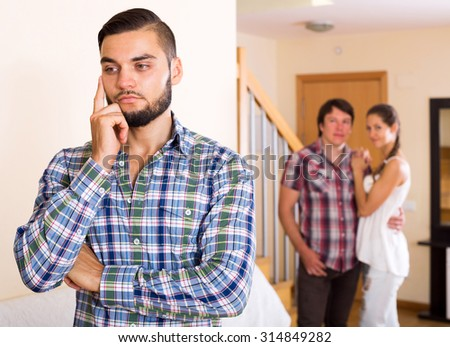 Quarrel among adult couple at home interior  - stock photo
