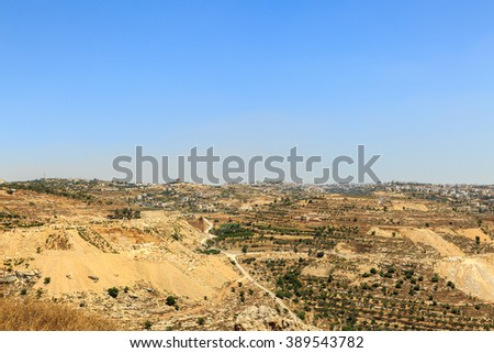 Quarry and olive groves near the city of Hebron, Israel - stock photo