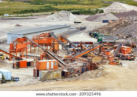 Quarry crusher plant in sand and gravel production - stock photo
