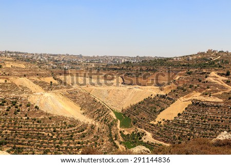 Quarry, olive groves and vineyards near the city of Hebron, Israel - stock photo