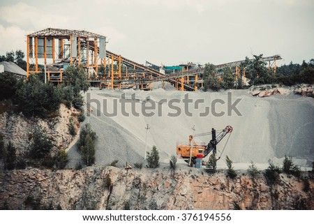 quarry stone, yellow machine works,  - stock photo