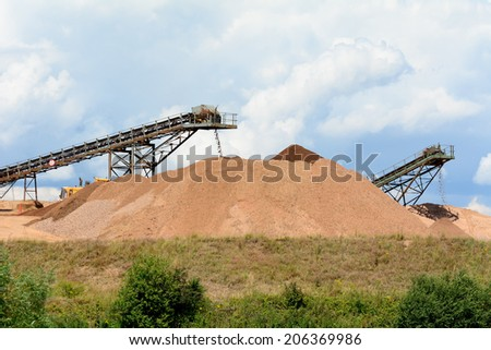 Quarry work - stone piles with conveyor belts