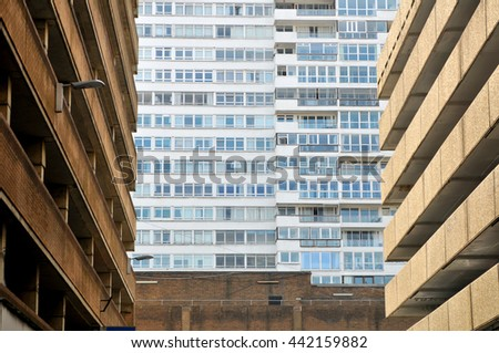 Quarter residential area with parking buildings and a big house with apartments / flats - stock photo