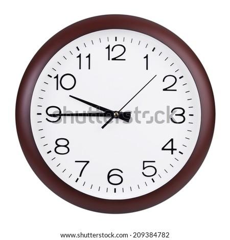 Quarter to ten o'clock on the round dial  - stock photo