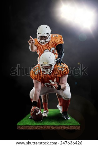 Quarterback and center organising a play - stock photo