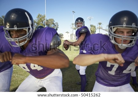 Quarterback Behind Linemen - stock photo