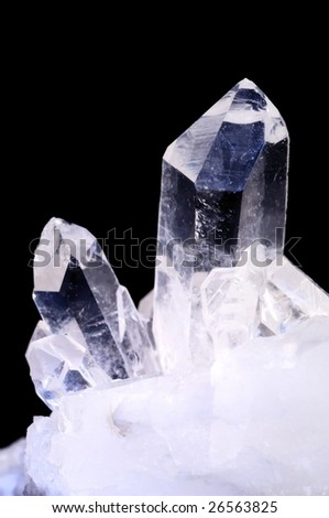 Quartz crystals on black background - stock photo