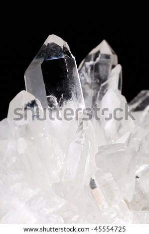 Quartz crystals on black background - stock photo