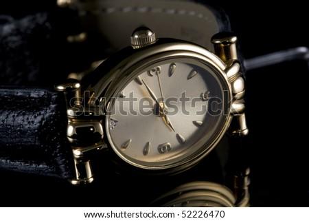 Quartz wrist watch on black background - stock photo