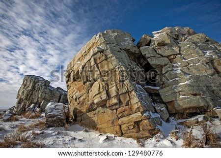 quartzite geological formation carried to the prairie by glacial movement - stock photo