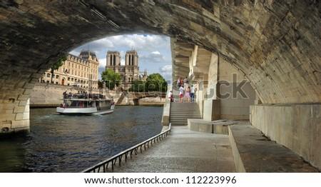 "Quay St. Michel of river Seine and cathedral ""Notre Dame de Paris"" in Paris, France. - stock photo"