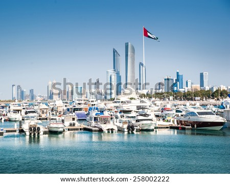 quay with yachts and skyscrapers in Abu Dhabi. UAE - stock photo