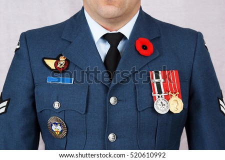 QUEBEC, CANADA - NOVEMBER 11, 2016: Air force corporal wearing red poppy lapel pin on Canada remembrance day, November 11, 2016. Memorial day observed in Commonwealth to remember the dead World War 1.