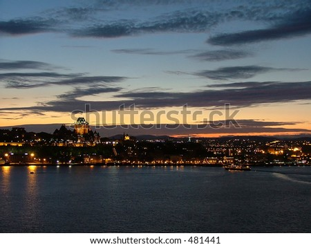 Quebec city at dusk from across the St-Laurence river. - stock photo