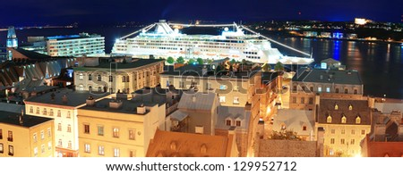 QUEBEC CITY, CANADA - SEP 10: Cruise ship and buildings on September 10, 2012 in Quebec City, Canada. As the capital of the Canadian province of Quebec, it is one of the oldest cities in North America - stock photo