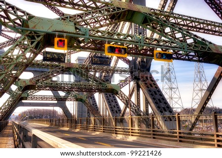Quebec city's cantilever bridge with moving car. - stock photo
