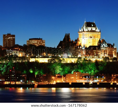 Quebec City skyline at dusk over river viewed from Levis. - stock photo
