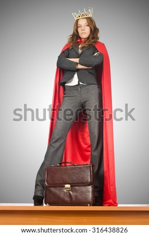 Queen businessman standing on the desk - stock photo