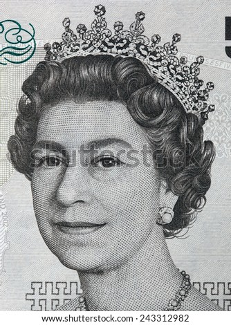 Queen Elizabeth II portrait on 5 pound sterling banknote. British currency - stock photo